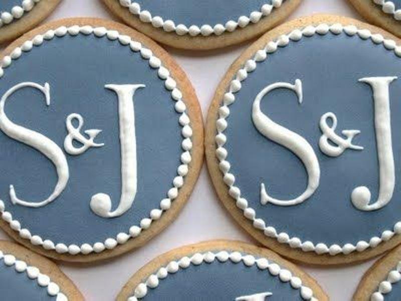 elegant black and white glazed cookies for a vintage inspired wedding or rehearsal dinner