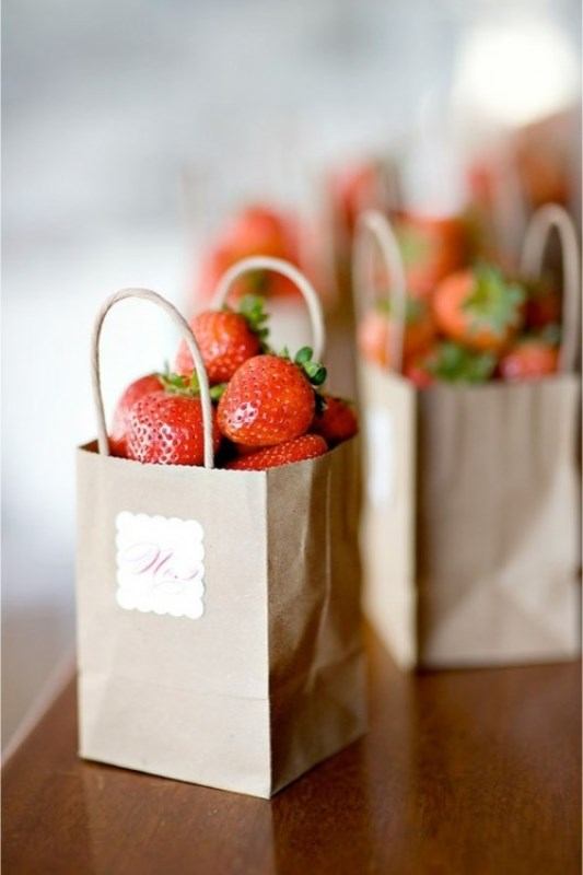 fresh strawberry in paper bags is a great summer wedding or rehearsal dinner favor idea