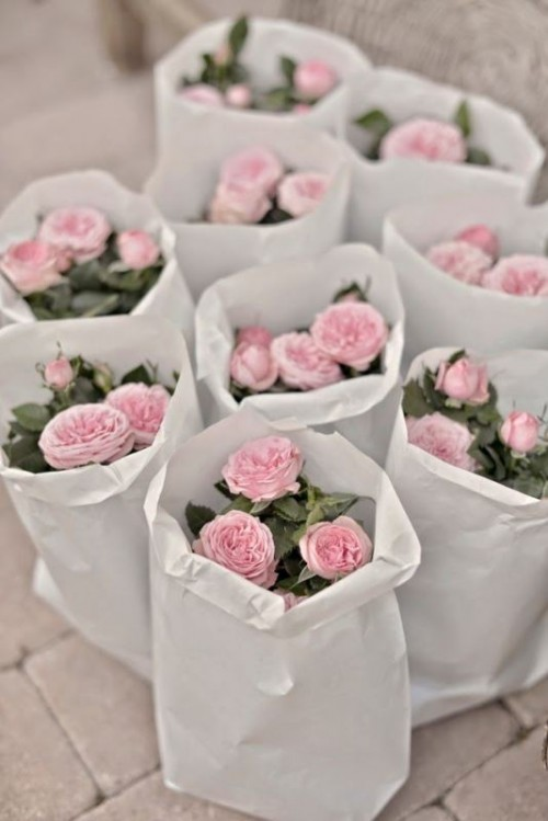 fresh potted peonies or roses are a cool idea for a spring or summer flower-filled rehearsal dinner or wedding