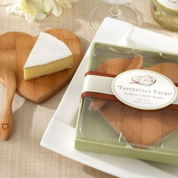 a bamboo cheese board and a matching spreader is a great favor idea if you two love cheese