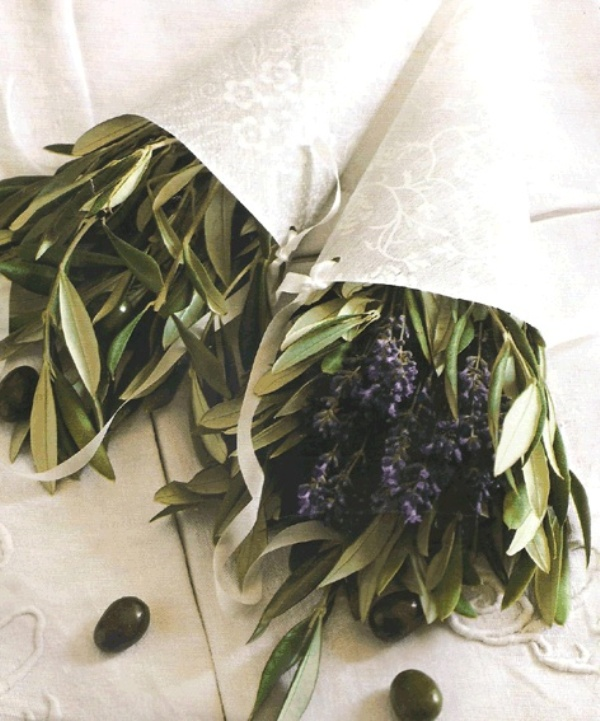 go for lavender in a cone and olive branches with olives as wedding decorations to embrace the wedding location