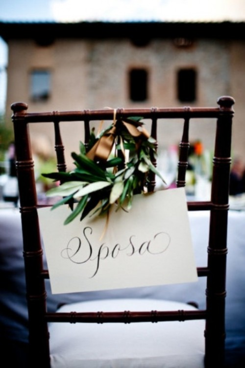 decorate your wedding chairs with signs in Italian and olive wreaths for embracing the location