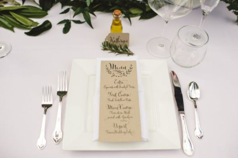 accent your wedding tablescape with natural local greenery and leaves to embrace the location