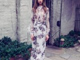 a white maxi dress with dark floral prints, a fitting bodice and long sleeves plus a high neckline for a formal spring or summer wedding