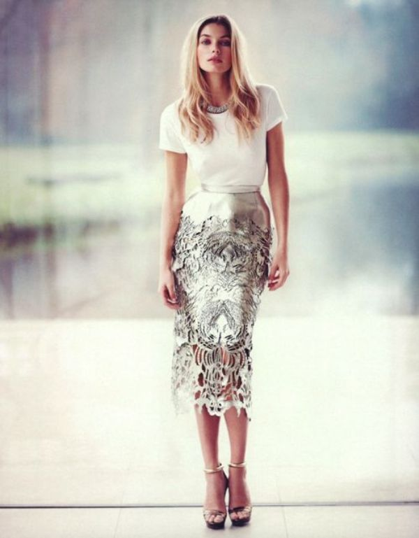 a white top, a metallic laser cut midi pencil skirt, metallic ankle strap shoes and a statement necklace