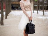 a timeless look with a blush lace top with long sleeves and a white tulle knee skirt, blush heels and a black tote plus a dark lip