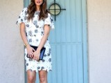 a bold white over the knee dress wiht black floral patterns, short bell sleeves, black heels and a black clutch are an elegant and timeless look