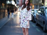 a bright floral mini dress with a high neckline and bell sleeves plus silver strappy heels for a fresh and timeless look at a spring or summer wedding