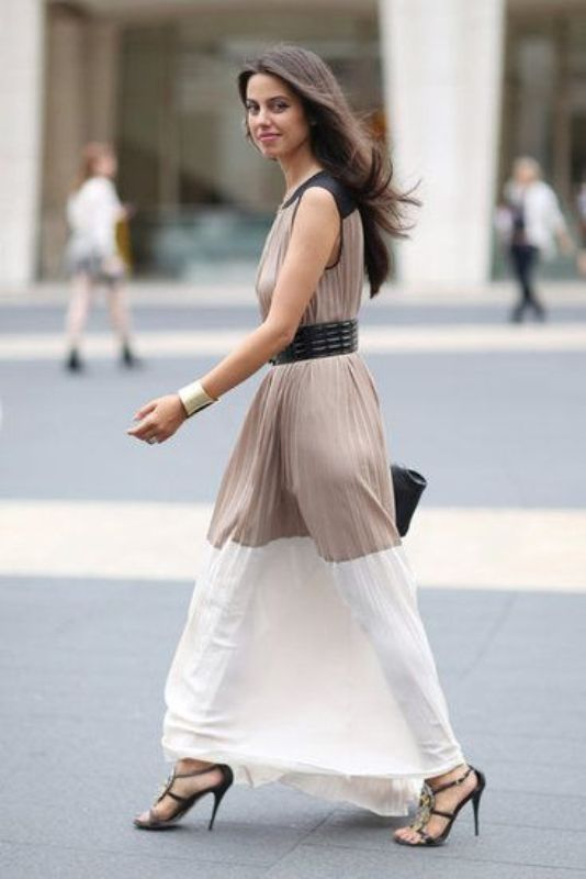 a statement color block maxi pleated dress with black shoulders, a taupe bodice and a white skirt, black heels and a bag for a fall wedding