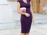 a deep purple midi fitting dress with a V-neckline and cap sleeves, a necklace, nude shoes and an updo for a timelessly chic look