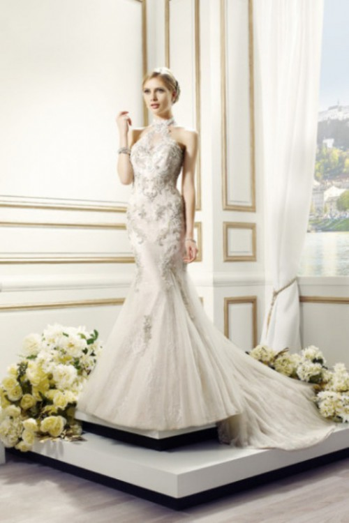 a glam lace embellished mermaid wedding dress with a halter neckline and a train