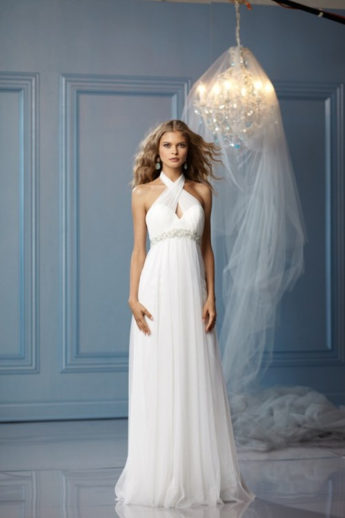 a Grecian-style wedding dress with a halter neckline, a cutout element and an embellished sash to highlight the dress