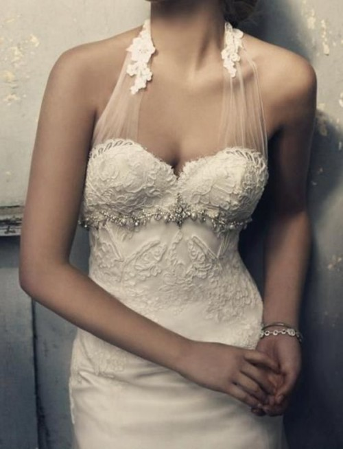 a creative lace embellished sheath wedding dress with a halter neckline is a chic and refined idea