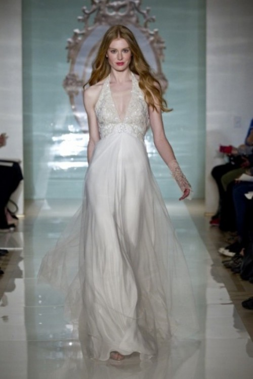 an A-line wedding dress with an embellished bodice and a layered skirt is a romantic idea