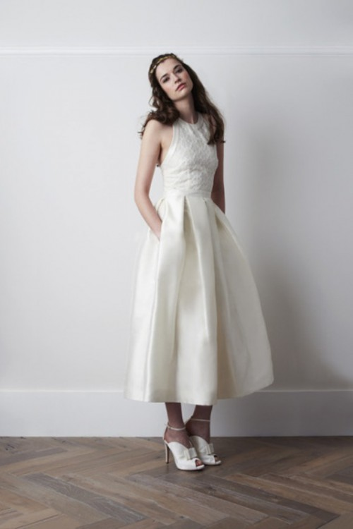 an A-line midi wedding dress with a lace bodice and a plain pleated skirt plus pockets