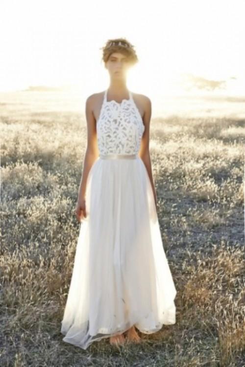 an A-line boho wedding dress with a lace halter neckline bodice and a plain skirt