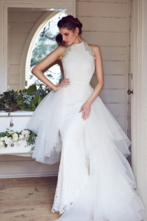 a transformable sheath wedding dress with a lace bodice and a tulle overskirt to look bold