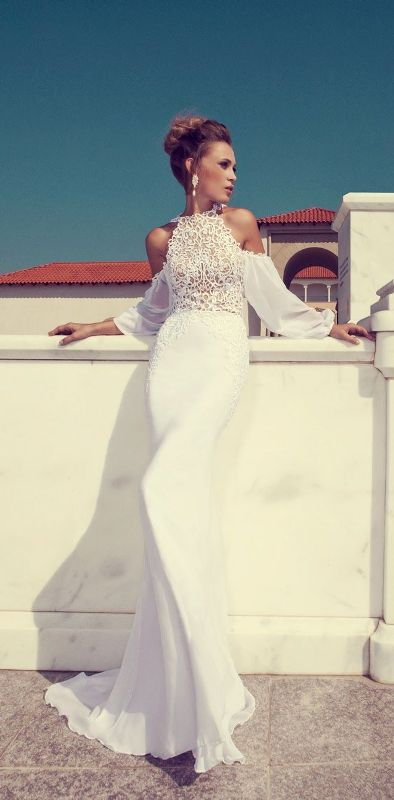 a sheath halter neckline wedding dress with a lace bodice and flowy off the shoulder sleeves