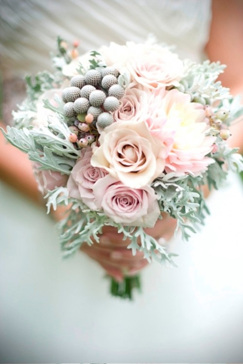 a pastel wedding bouquet with pale millet, pink roses and some berries for a spring or summer bride