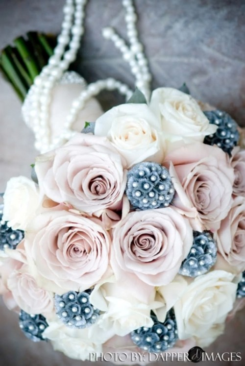 a dusty pink and white rose wedding bouquet accented with pearls is a cool and fresh idea