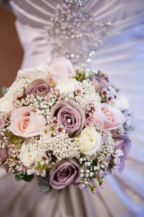 lilac and blush blooms, white ones and baby's breath plus some eucalyptus for a pretty bouquet