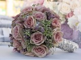 a dusty pink rose and greenery wedding bouquet looks very whimsical and veyr catchy