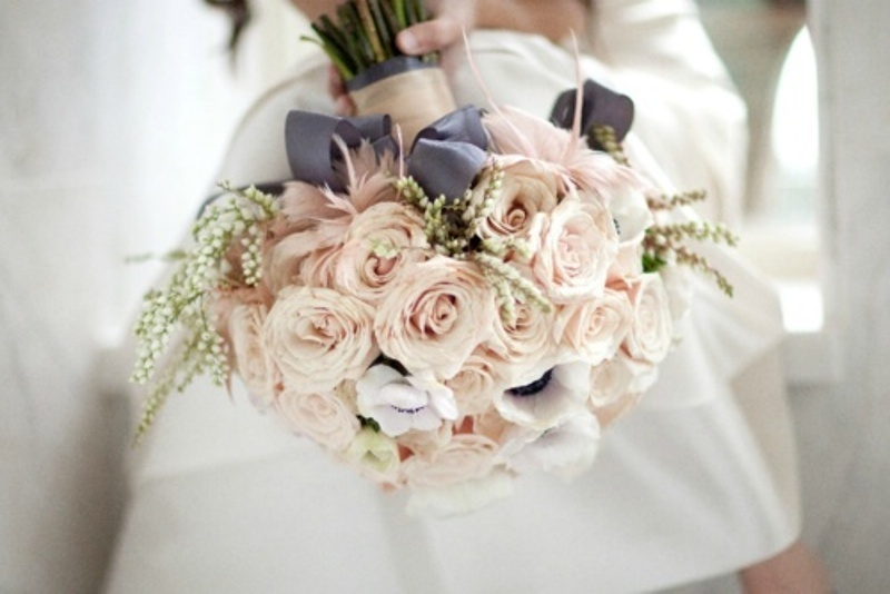 a romantic blush rose wedding bouquet with some berries and dark ribbons for a chic look
