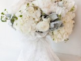 a neutral and blush wedidng bouquet with pale greenery and millet plus some usual greenery for a texture