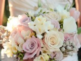 a pastel wedding bouquet done in dusty pink, blush pink and neutral plus some berries and greenery