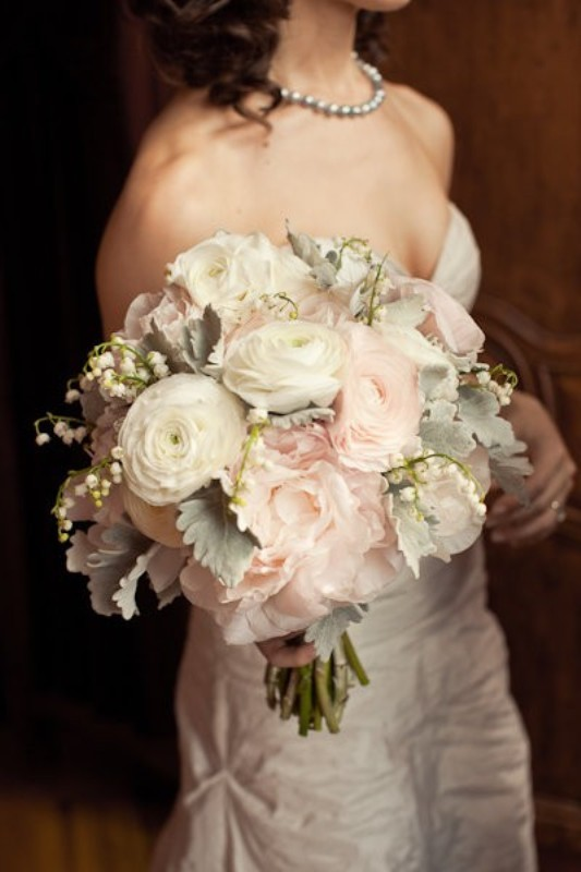 a pastel wedding bouquet of white and blush blooms, pale millet and some lilies of the valley
