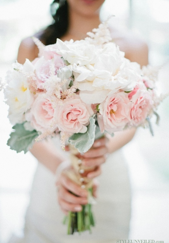 a chic wedding bouquet of white and blush blooms and some pale greenery plus plenty of texture