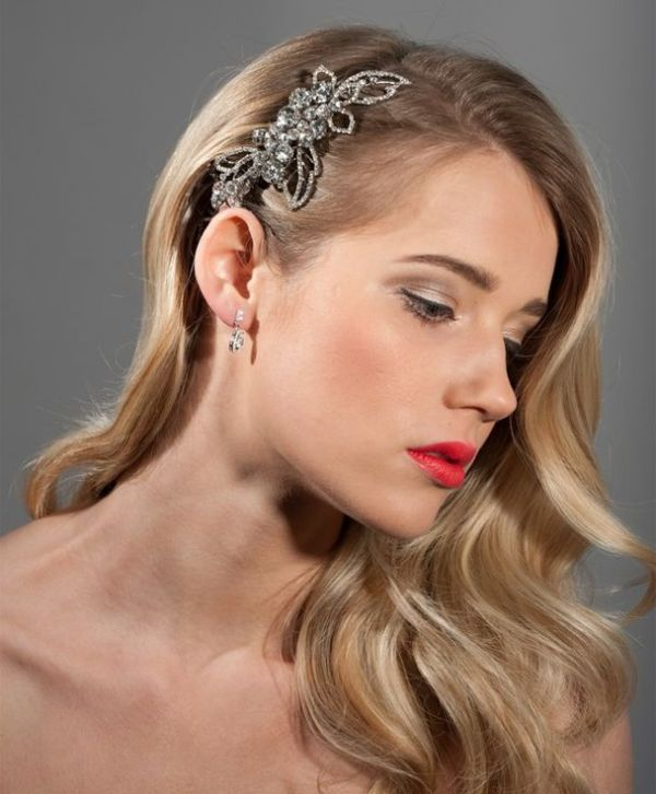 vintage waves on one side accented with a large embellished hairpiece look very refined and chic