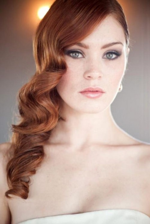 long amber hair in vintage curls looks very elegant and such a structure highlights the color of hair