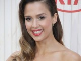 a sleek top and some vintage waves down is a very elegant and chic hairstyle that rocks