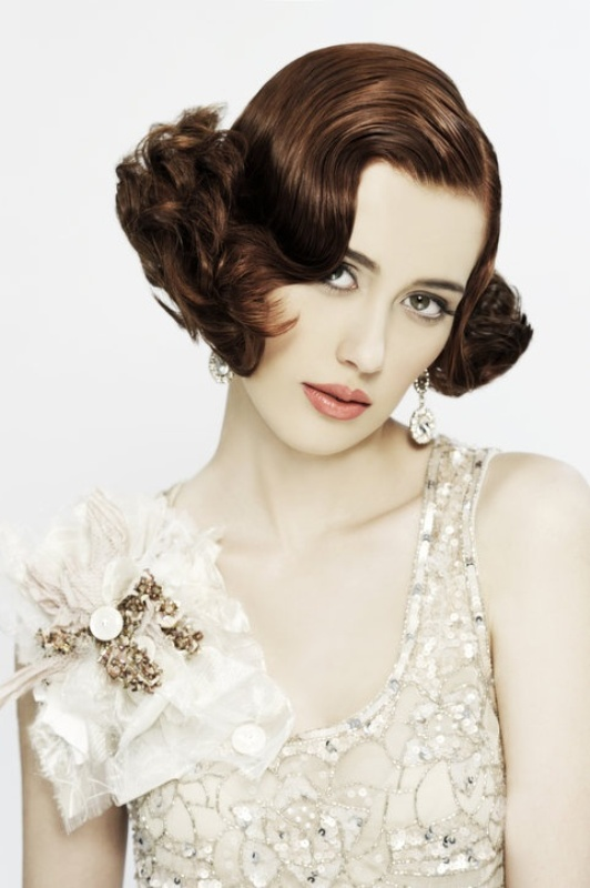 short dark hair with curly edges looks very vintage like and very chic, such a hairstyle will complement many refined looks