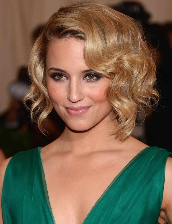 a low updo accented with vintage waves that frame the face looks very chic and very elegant