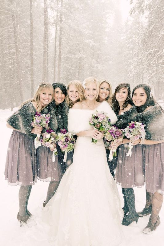 faux fur coverups match the bridesmaid dresses and make gals feel comfortable, cozy and warm