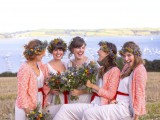 coral pink cardigans add color to the bridesmaid looks, match red sashes and finish off their country outfits