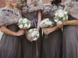 faux fur coverups match the long bridesmaid dresses and keep the girls warm and comfortable