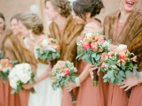 elegant faux fur coverups match the bright bridesmaid dress color and add chic to the looks