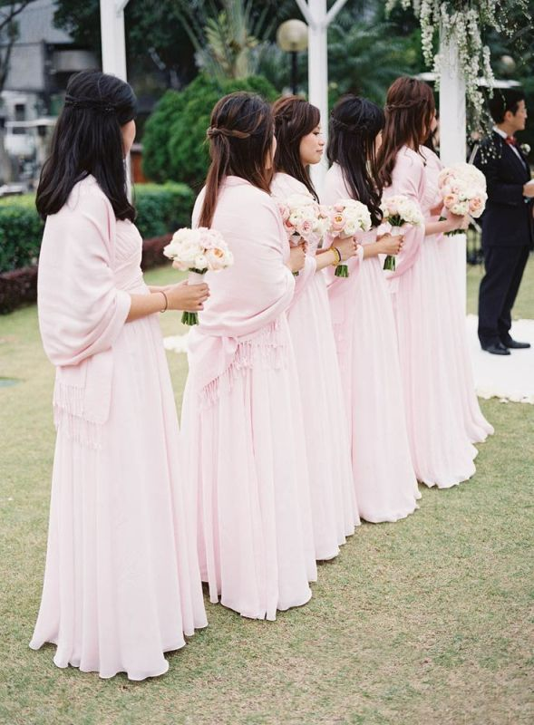 chic light pink pashminas match the bridesmaid dresses and look chic and very girlish