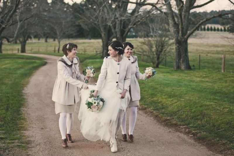 short coats that match the bridesmaid looks and keep the girls warm and very chic