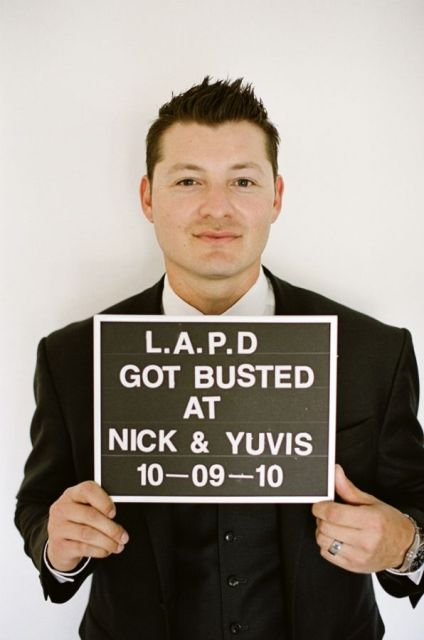 a funny police-inspired wedding photo booth prop showing off your wedding date and names