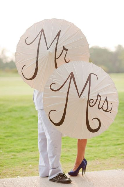 simple Mr and Mrs paper umbrellas are super cute and fun props to use for taking pics