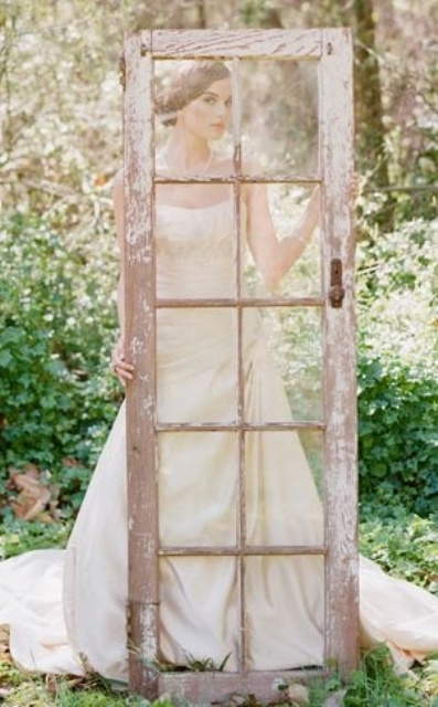 a shabby chic door with glass is a unique wedding photo booth prop that will give vintage chic to your pics