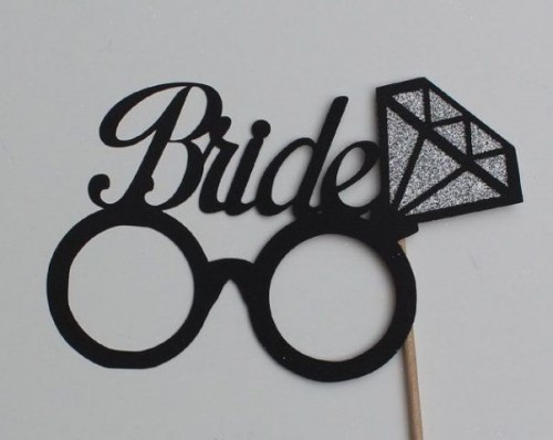 a special prop for the bride - glasses with a diamond and a proper sign