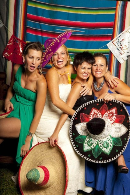 Mexican hats and colorful paper banners are gorgeous fun props for a Mexican themed wedding