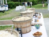 a cozy popcorn bar with wooden baskets with popcorn, lanterns, condiments and sprinkles