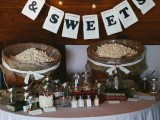 a relaxed popcorn bar with buckets with popcorn, sprinkles and sweets and letter banners