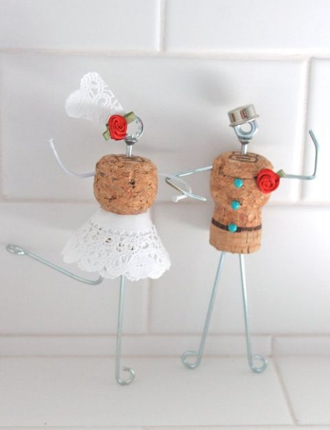 funny cake toppers of wine corks, wire, lace, buttons and fabric blooms can be DIYed by you yourself
